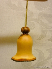 Plum wood Christmas bell ornament
